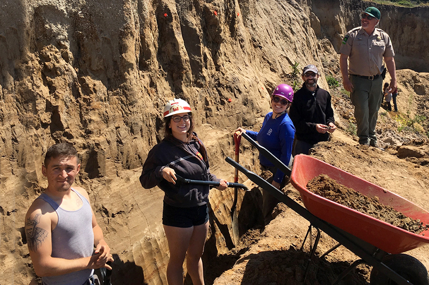 Geoplogy students examine a site at the San Gregario fault at Pillar Point Bluff, Calif.