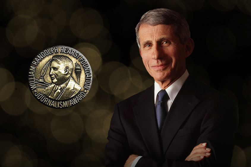 Dr. Fauci in a black suit and crossed arms smiling with the Hearst Award medallion next to him.