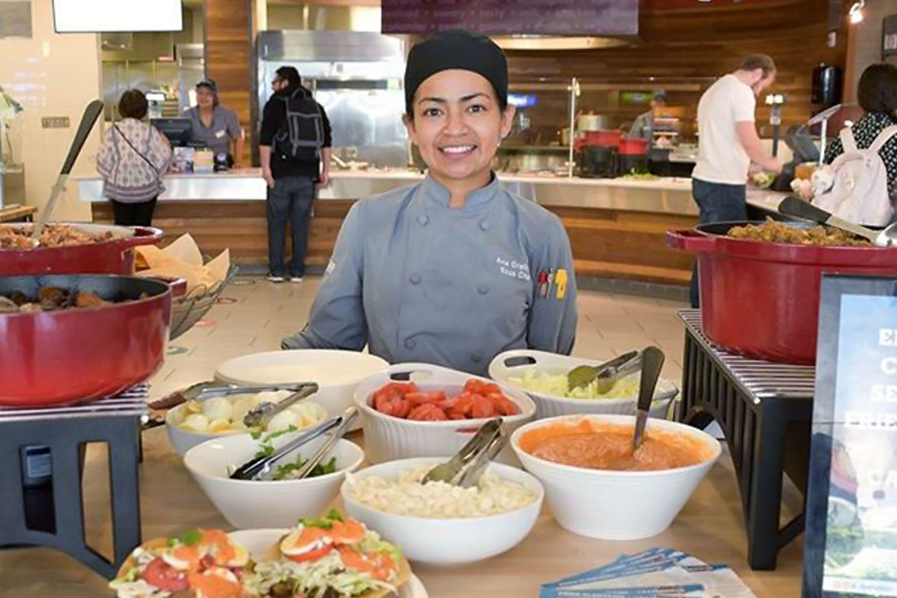 Spartan Eats employee serving food at the Student Union.