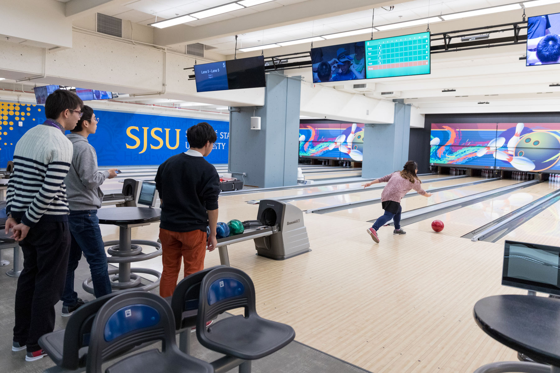 Students bowling at the Bowling Center in the Student Union.