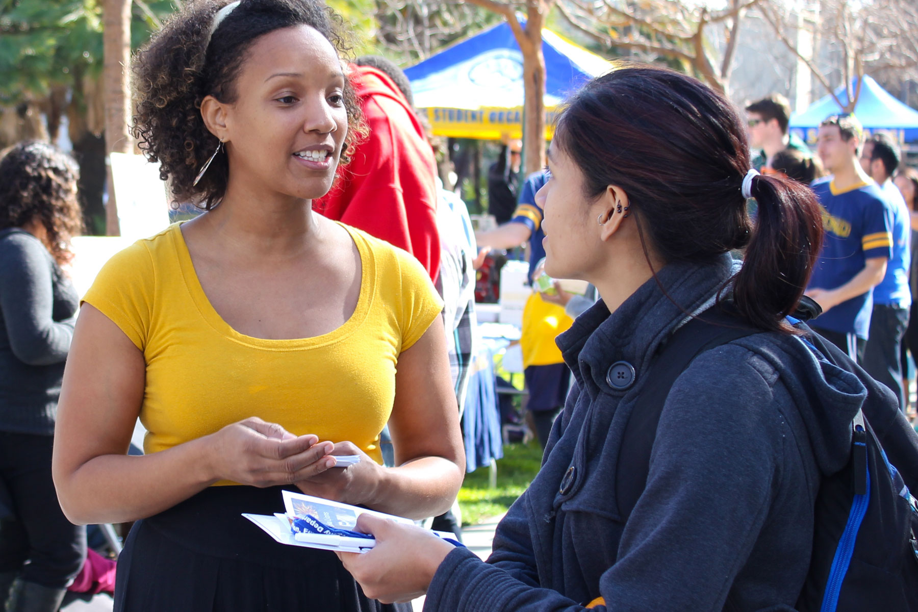 SJSU student receiving information on sexual assault and intimate violence.