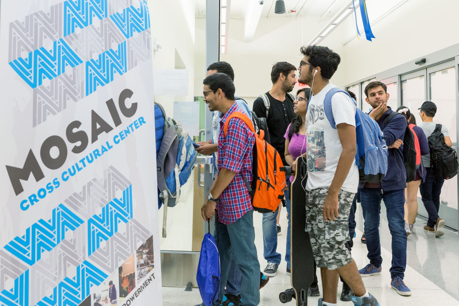 Students entering the MOSAIC Cross Cultural Center at the Student Union.