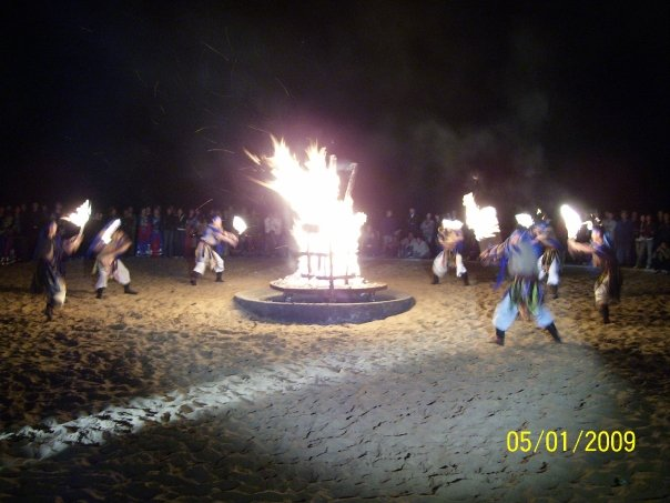 Ethnic dancing around bonfire in Xiangsha Wan Desert, Inner Mongolia