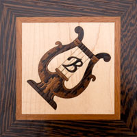 "Inlaid wood lyre with script ""B"""