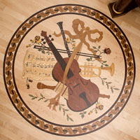 Inlaid wood floor medallion featuring a violin and other musical instruments