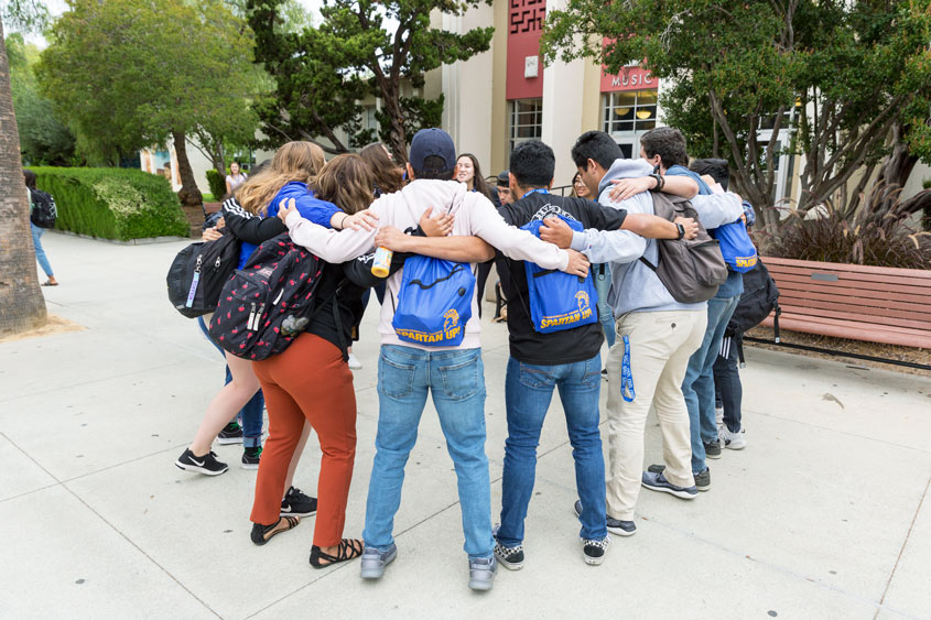 SJSU students embracing during Frosh Orientation.