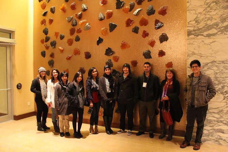 MARC Students in front of a rock climbing wall.