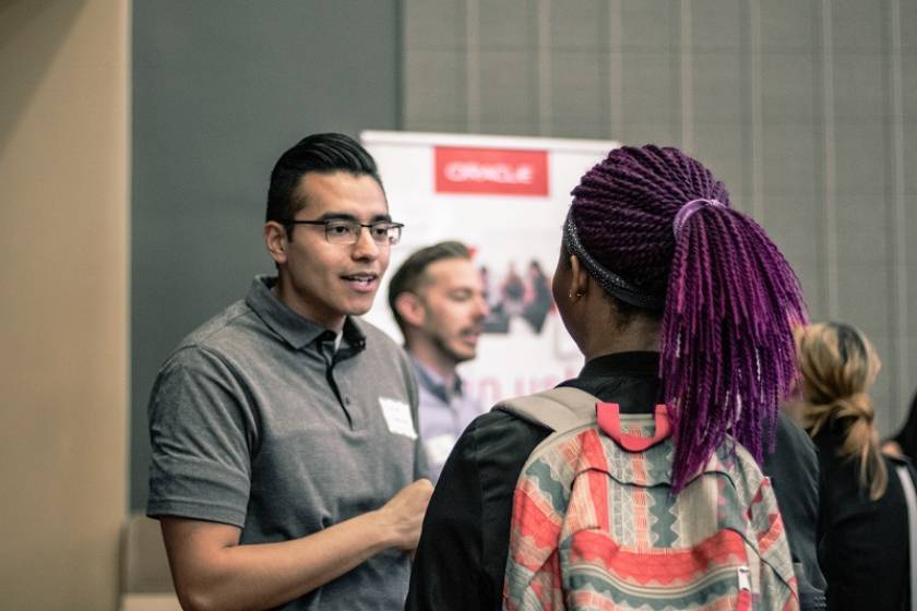 recruiter talking to student at career fair