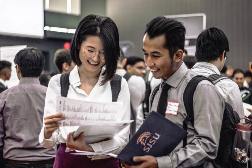 two students attending career fair