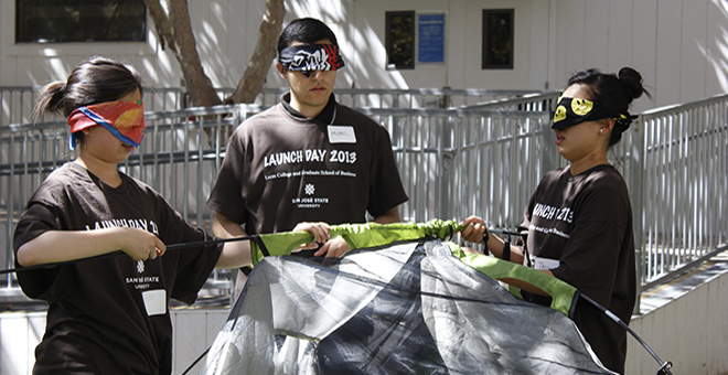 Students building tent blindfolded