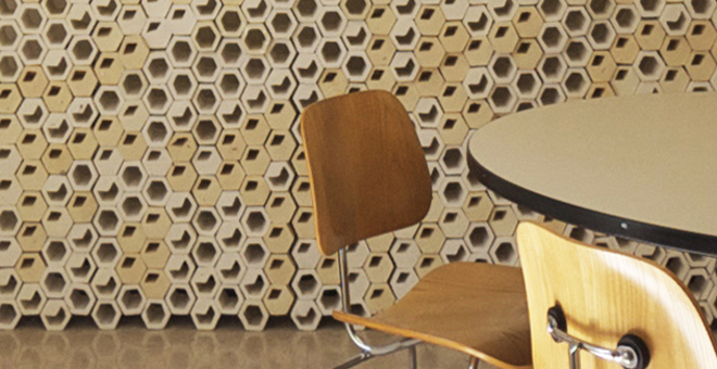 Chair in front of a honeycomb wall