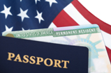 A pasport in the forground with an american flag in the background.