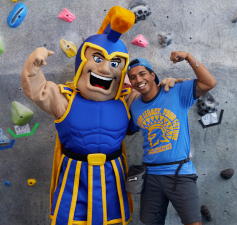 Student posing with SJSU mascot, the Spartan