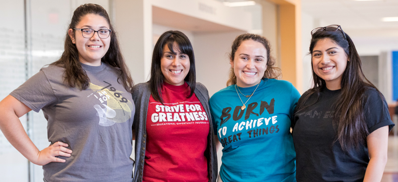 Four EOP students show off their colorful EOP t-shirts.