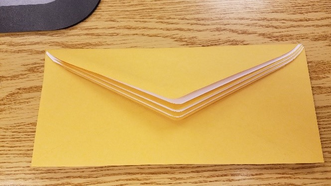 Envelopes interleaved so flaps stack on top of each other