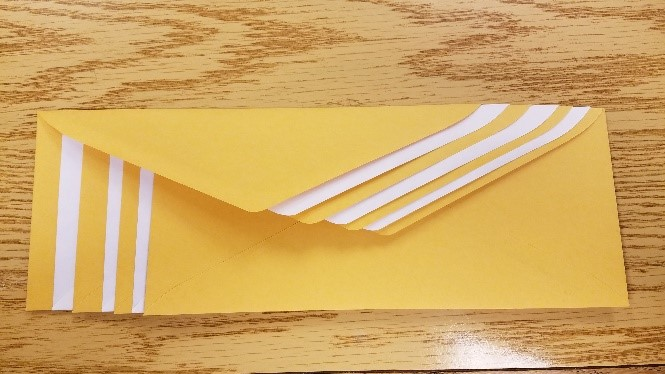 Envelopes interleaved so flaps are stacked on top of each other