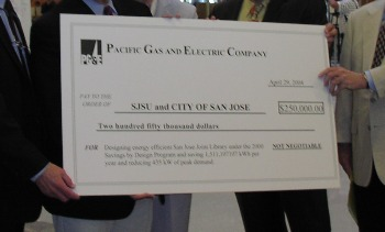 PG&E Presents Check to the library