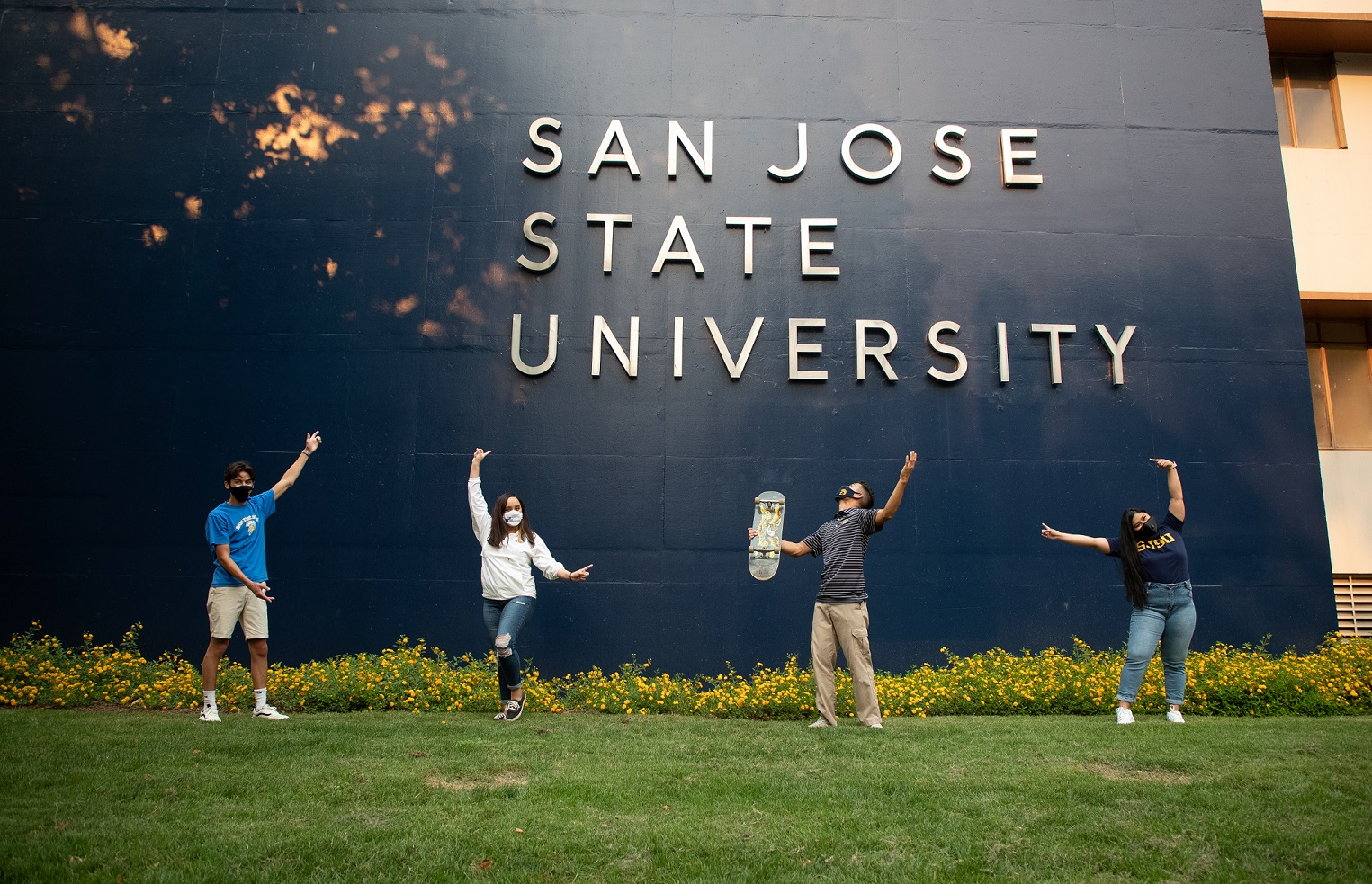 Students in front of San Jose State University wal