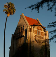 A picture of Tower Hall and a palm tree