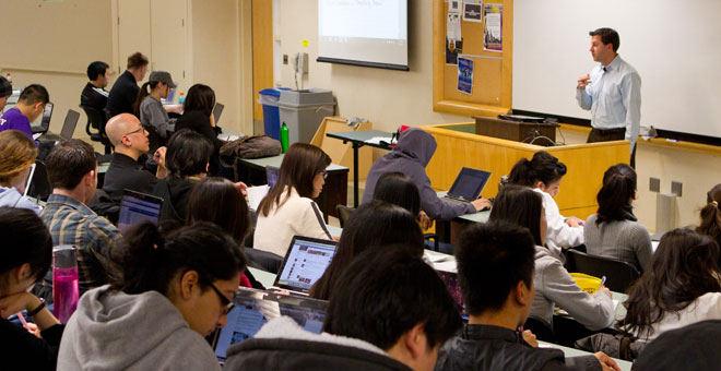 SJSU students attending a course in a large lecture hall.