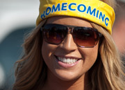 A photo of a student wearing a homecoming hat
