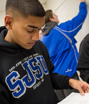 A photo of a student wearing an SJSU sweatshirt