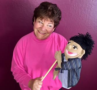 Linda Levine with puppet