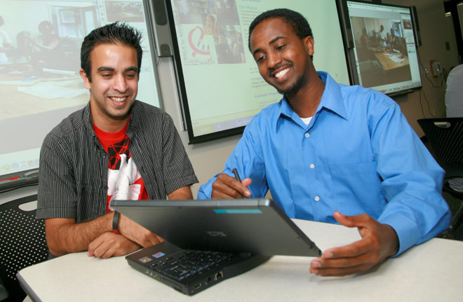 Two students with laptops