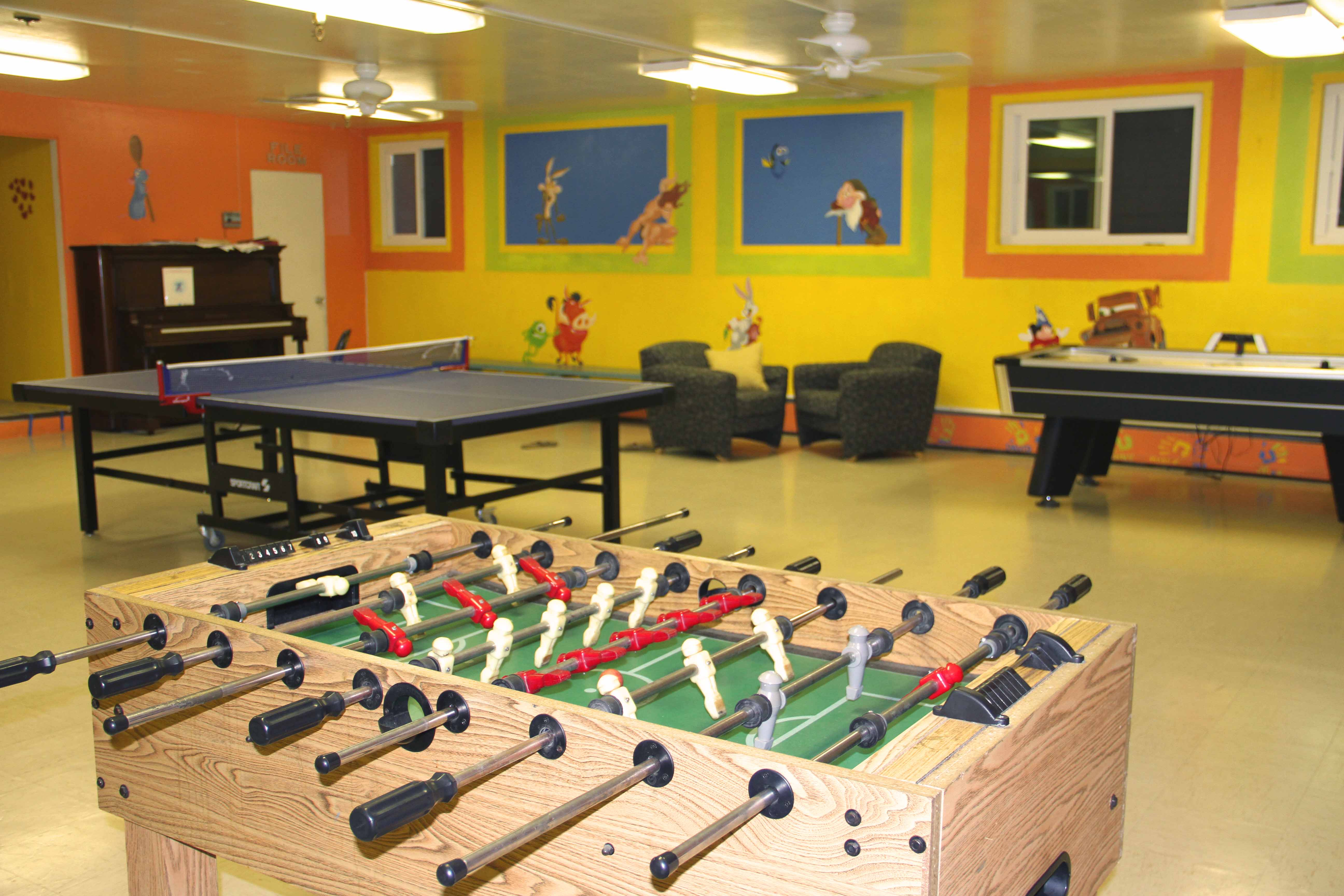 Residents Playing Fussball in Recreation Room