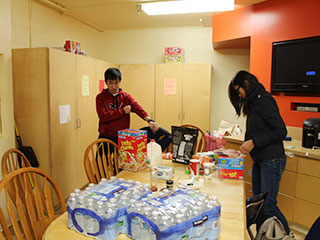 Residents Storing Groceries in Student Kitchen