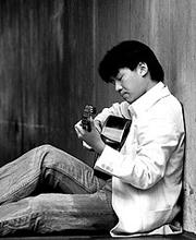 Steven Lin playing a guitar