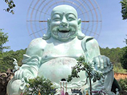 photo of laughing buddha in vietnam