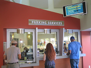 customers being served at parking office