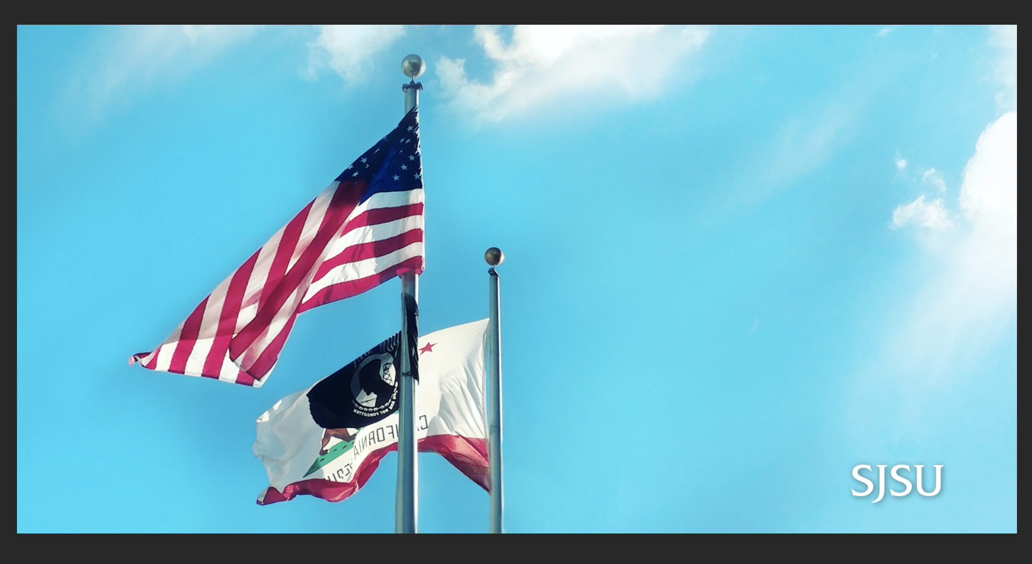 American and State CA flag whipping in the wind.
