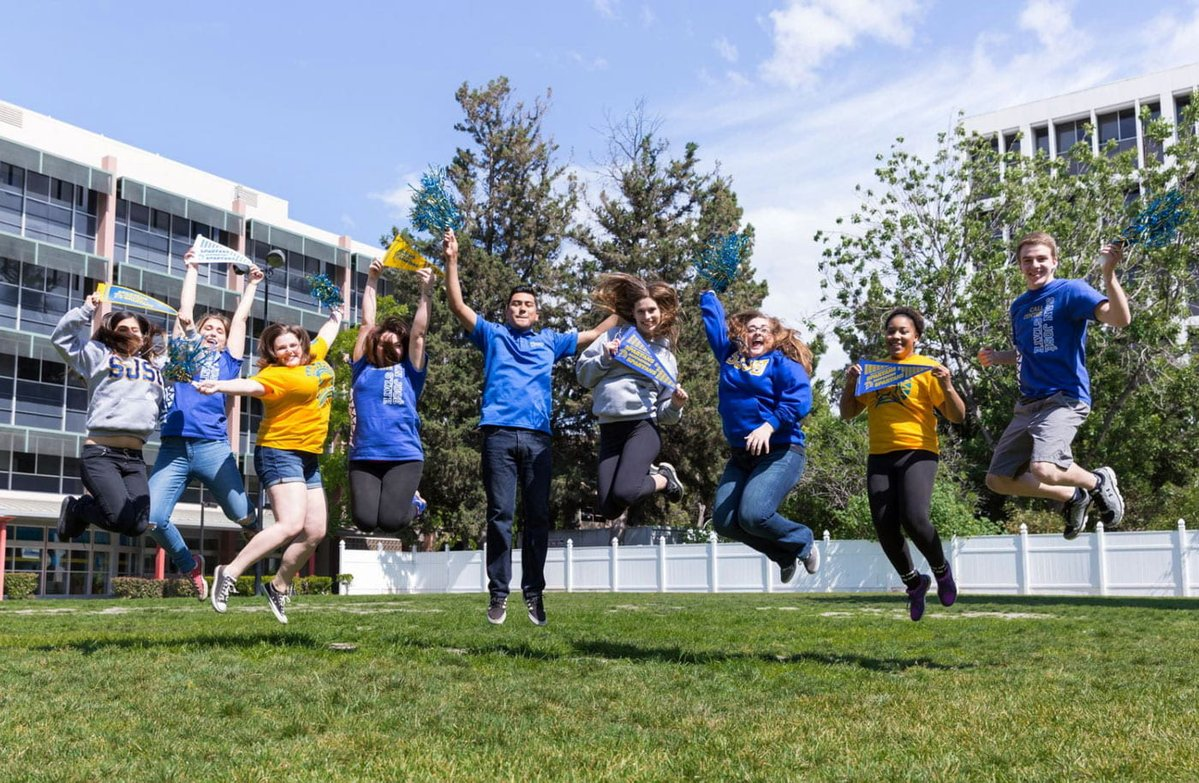 SJSU students jumping in celebration