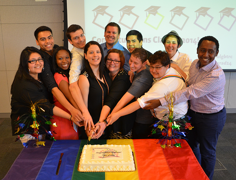 Rainbow Grads cutting a cake