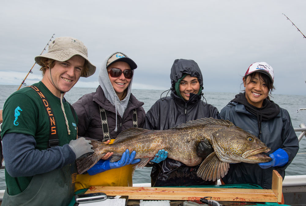 Students with large ling cod