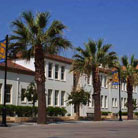 photo: Central Classroom Building lined with palm trees along El Paseo de Ceasar Chavez