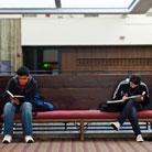 Two Asian Students Sitting on Bench
