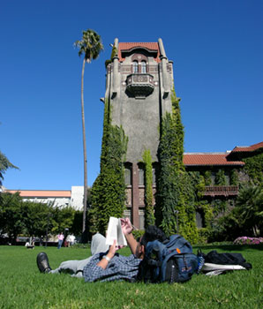 A Student Relaxing on Tower Lawn