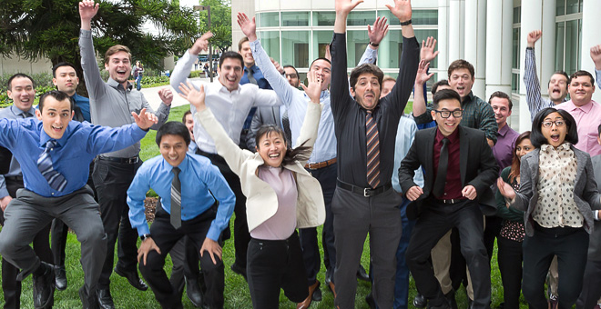 Students and Faculty from the College of Engineering jump for joy for a celebratory photo