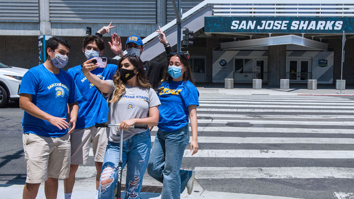 Students taking a photo at the Shark Tank in the SAP center.