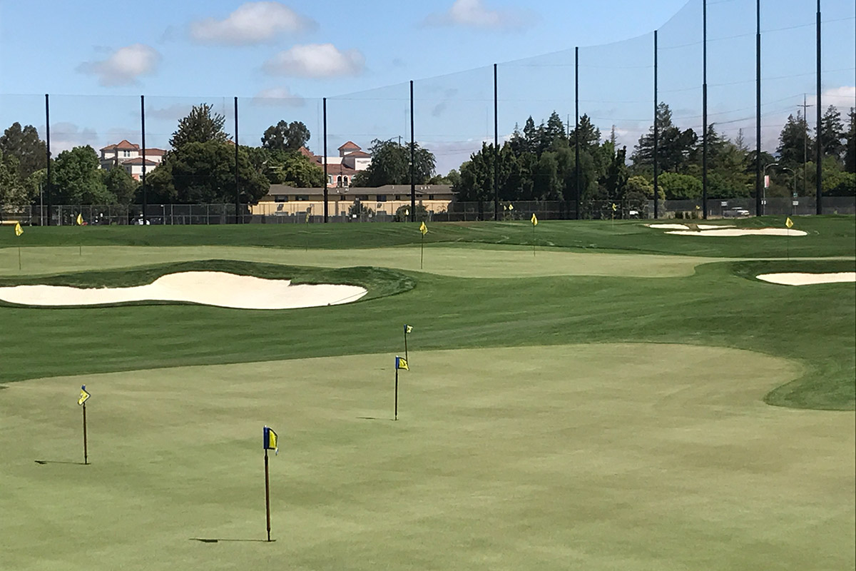 photo of short game area at Spartan Golf Complex, showing putting greens and chipping area