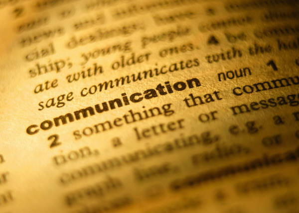 page of dictionary highlighting the word, communication