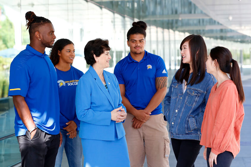 President Mary Papazian chatting with diverse students.