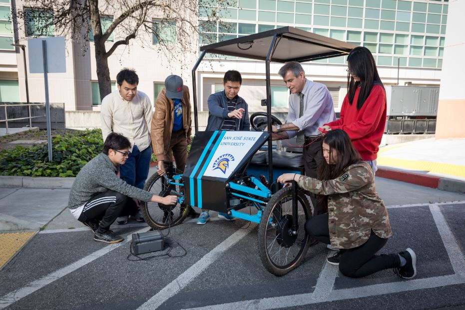 students work on solar golf cart