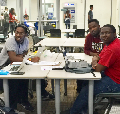 Group of students working on laptops at the AABSSC