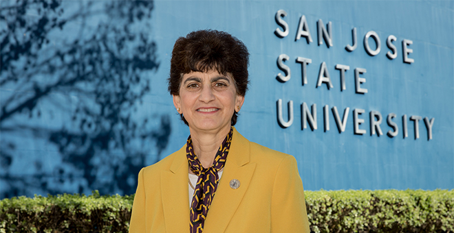 Image of Dr. Mary Papazian in front of building that reads San Jose State University