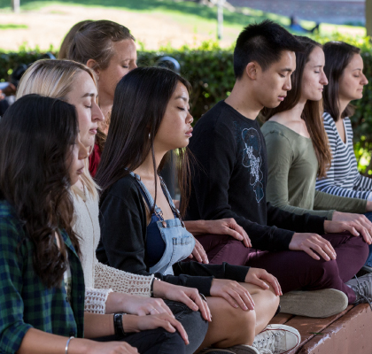 Group of students doing meditation